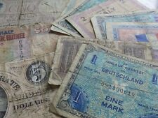 selection of old banknotes as shown