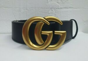 Gucci  black belt and GG golden tone buckle