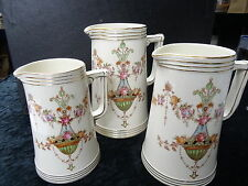 Set of 3 Graduated Devon Ware Jugs. Reg Mark C1887 ETNA Pattern