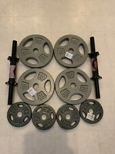 50Lb. Adjustable Dumbbells, (4) 10 lb. Plates, (4) 2.5 lb. Plates, 2 Handles CAP
