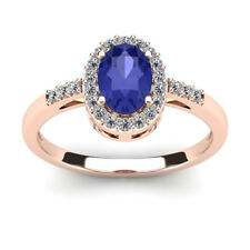14K ROSE GOLD 1 CARAT OVAL SHAPE TANZANITE AND HALO DIAMOND RING
