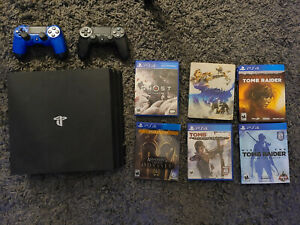 Sony PlayStation 4 Pro 1TB Black Console Bundle with games and two controllers