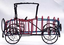 Old style folk art car made from colored telephone wire by C. Dale (in museums).