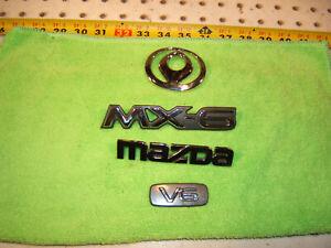 Genuine Mazda MX-6 V6 1997 front & rear deck Plastic Chrome 1 set of 4 Emblems
