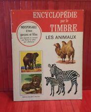 vintage 1967 Encyclopédie par le Timbre.  # 1 . les Animaux . stickers book.