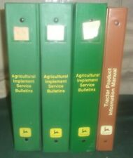 Lot of 4 John Deere binders with service bulletins for agricultural equipment