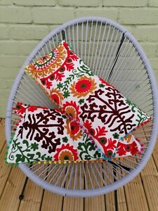 pair of indian folk art crewel work embroidery pom pom cushions bright floral