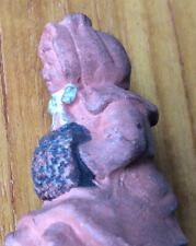 Old Ceramic/Clay Girl Figurine,Hands In Muff Wearing Bonnet, Good Condition