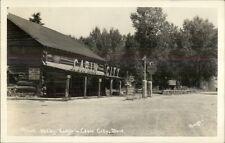 Cabin City Mt Roadside Shell Gas Station & Lodge Real Photo Postcard