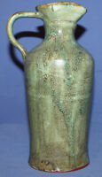 Vintage hand made glazed pottery pitcher