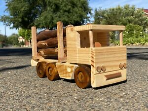 Handmade wooden toy Log truck Includes logs.