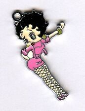 Pretty girl in pink dress w/net leggings alloy charm or pendant.