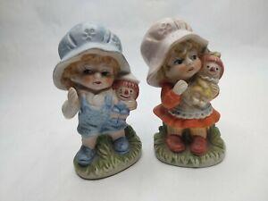 Set (2)Unmarked Ceramic Boy Girl with Bonnet & Raggedy Ann Andy Doll Figurine