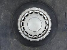 "VINTAGE UNKNOWN 14"" VOLKSWAGEN FACTORY OEM WHEEL AND TIRE/70-80% WITH CENTER CAP"
