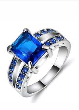 Blue Sapphires in a ring of Filled White Gold Size 6 JoMacDesigns