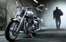 Framed Print - Biker Walking away from his Harley Davidson Motorbike (Picture)