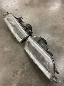 ROVER COUPE PAIR OF HEADLIGHTS O/S & N/S DRIVERS PASSENGER SIDE-USED-SOLID PAIR