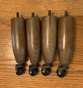 VINTAGE OAK WOODEN LEGS WITH CASTER WHEELS SET OF 4