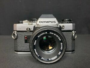 OLYMPUS OM10 with lens