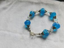 Aqua Blue lampwork rondelle beads with crystal bracelet