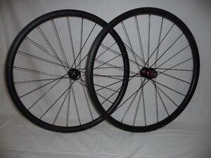 Carbonal 30mm deep lightweight carbon disc brake clincher wheels.