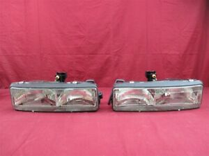 NOS OEM Oldsmobile Cutlass Supreme 4-Door Headlamp Light 1992 PAIR