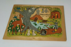 FISHER PRICE WOODEN JIGSAW WOODLAND ANIMALS 523 E AGE 1.5 -4 BABIES BEHIND