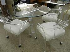 MID CENTURY LUCITE KLISMOS TUSK TABLE WITH 4 LUCITE CARVER CHAIRS ON CASTERS
