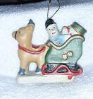 Vintage Christmas Figurine/Ornament Rudolf pulling Santa's Sleigh Fill With Toys