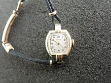 VINTAGE LADIES MOVADO 14K SOLID GOLD WRISTWATCH RUNNING AND KEEPING TIME