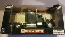 1/32 New Ray Die cast & Plastic Kenworth W900 Long Hauler, in package.