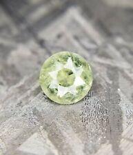Natural Montana sapphire: I, green/yellow round gemstone 0.54 ct
