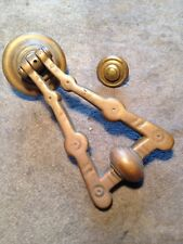 door knocker. antique brass early victorian pendant.