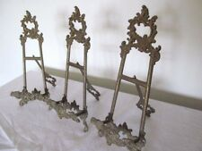 THREE ORNATE ANTIQUE  / VINTAGE BRASS EASEL PHOTO FRAMES.