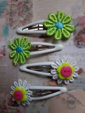 TWO SETS OF HAIR SLEEPIES GREEN & WHITE DAISIES ON ENAMEL CLIPS