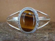 Navajo handmade sterling silver bracelet with oval Tiger's Eye Stone (A)