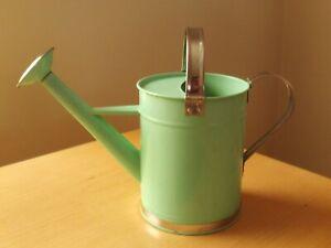 Green & Silver Metal Watering Can.