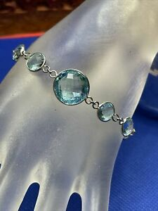 "Sky blue topaz station bracelet rhodium plated sterling silver 8.25"" 30.00 ctw"