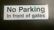 polite sign NO PARKING IN FRONT OF GATES, rigid composite material