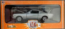 M2 Machines1966 Ford Mustang GT 2+2 Fastback Silver with Red Line tires 1/24