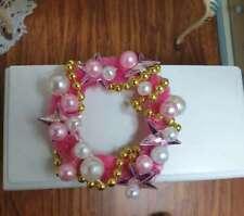 Miniaturas escala 1:12. Pequeña Corona de Navidad . Tonos rosas
