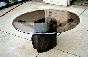 Carved (Drum-like) Hollowed Wood With Glass Top Coffee Table