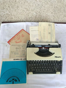 Olympia SF De Luxe typewriter with all paper