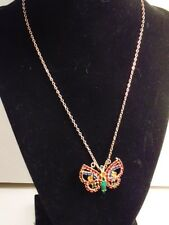 Gold colored necklace with butterfly pendant accented with colorful crystal