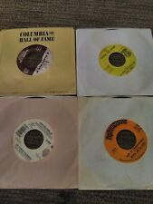 5 Vintage 45 records in sleeves,  Hank Williams Jr., Andy Williams, Brenton...