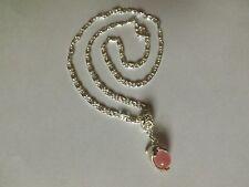 collier argenté avec pendentif dauphin perle oeil de chat rose