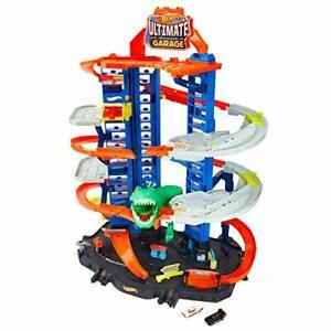 Hot Wheels City Super Dino Robot Garage avec T-Rex pour contenir jusqu'à 100 ...