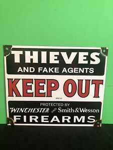 VINTAGE PORCELAIN THIEVES KEEP OUT S&W AND WINCHESTER FIREARMS SIGN