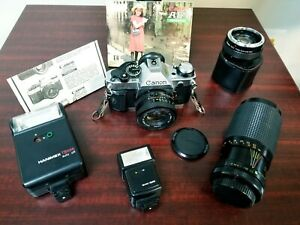 Canon AE-1 Program 35mm SLR Film Camera with multiple lens