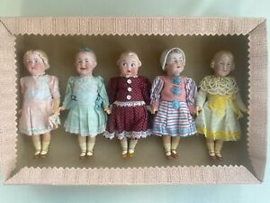 5 antique porcelain head dolls in a box - brothers Heubach